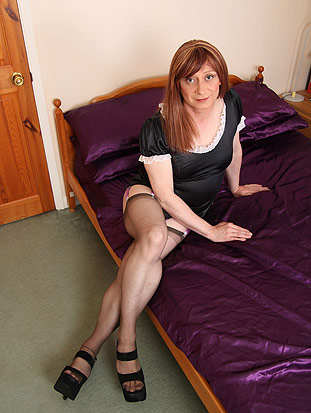 Tgirl Luci is dressed in a cute  maids outfit from Luci May