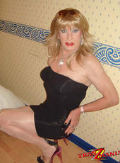 Crossdresser at home showing off various outfits